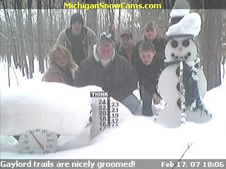 Tom, Pam and Cody Wyatt with Roger, Kevin and Teri standing next to the snowman.