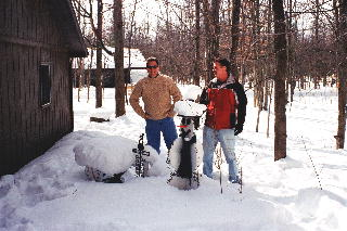 Gary and Gilles from Fremont Ohio standing next to the snowman.